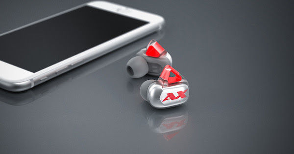 Axum Earbuds Next to iPhone